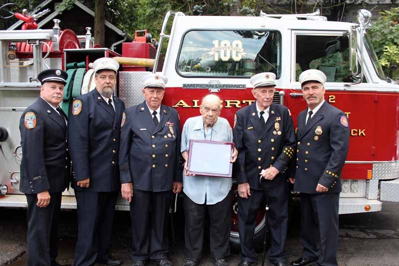 From left: Alert Fire Company's Michael Green, chairman of the board; Michael Berry, president; 70-year members Leonard Motchkavitz, Harry Rubenau and George Motchkavitz; Chief James Neubert