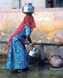 Woman with vessels, Nimaj, India