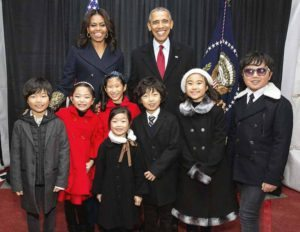 Joyous students, including 9-year-old cellist Victoria Lin from Lakeville Elementary School, performed for the Obamas.