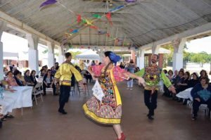 Russian dancers entertain the crowd.