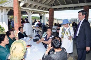 Supervisor Judi Bosworth and Town Clerk Wayne Wink greet guests at the Mashadi Senior Picnic.
