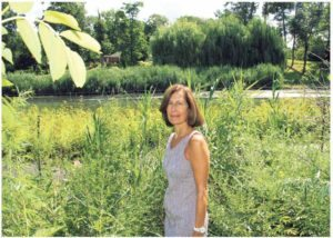 Nassau County Legislator Ellen W. Birnbaum stands in front of Udall's Pond in Great Neck.