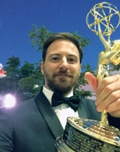 Christopher D'Elia, supervising producer of @midnight with Chris Hardwick, proudly displaying his Emmy