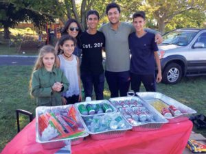 From left: FIDF Long Island teen leaders Ella Basha, Maya Ben-Josef, Sharleen Moradof, Aaron Sheena and Tyler Moradof, and a volunteer who handed out refreshments