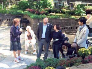 Councilman Rory Lancman talking with volunteers and Director Linda Spiegel (left)