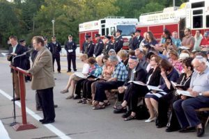 Rabbi Howard Stecker and Cantor Raphael Frieder (far left) of Temple Israel led a September 11 memorial service on the Saddle Rock Bridge, which was attended by congregants, members of the Vigilant and Alert fire companies as well as local officials.