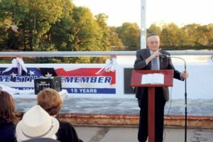 "With a view of the World Trade Center behind him and a banner reading ""We Still Remember,"" former Congressman Gary Ackerman talked about how he learned of the September 11 attacks at the memorial service organized by Temple Israel of Great Neck."