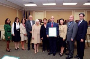 Town of North Hempstead Supervisor Judi Bosworth, the town board and Ron Gimondo's mother, Sonia, with Councilwoman Anna Kaplan's Hispanic Heritage Month honoree, Gimondo, principal of JFK Elementary School