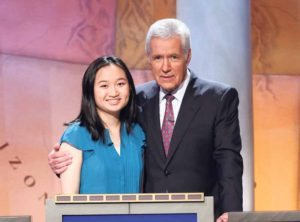 Lucia Geng with Jeopardy! host Alex Trebek