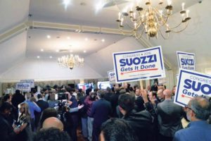 "Supporters held signs that read, ""Suozzi gets it done."""