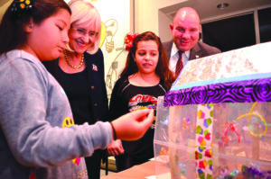 North Hempstead Supervisor Judi Bosworth and Councilman Peter Zuckerman view recycled art creations.