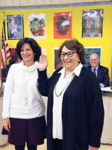 Donna Peirez (right) is sworn in as Board of Education trustee by Michele Domanick. (Photo by Joseph Catrone)