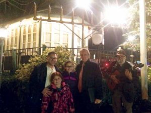Last year, the family of Salomon Nehmad gathered in front of the menorah to celebrate the second night of Hanukkah. From left: Albert Nehmad, Sarina Nehmad, Brooke Nehmad and Moshe Dann (Photo by Isabella Harnick)