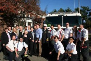 From left, back row: Manhasset-Lakeville Fire Department (MLFD) Firefighters Blaise Christoforatos, Matt Burke, Stephen John, Gary Halitzer and Doug Hwee; center: Beth Lilach, senior director of Education and Community Affairs at the Holocaust Memorial & Tolerance Center of Nassau County (HMTC); Phillis Lee, professor at Long Island University and George Oscar Lee's daughter; Steven Markowitz, chairman of HMTC; Holocaust survivors Leah Lee and George Oscar Lee; Mitchell Littman, George Oscar Lee's son; Deputy Chief Brian Stone, MLFD; and MLFD firefighters Sunjay Verma, Ex-Captain Matt Newman, Steve Lampert, Lt. Carly Farrone and Ed Hartrick; kneeling: MLFD EMT-CC Mitch Levine, Firefighter Dorin Rusu, EMS Henry Hong and EMS Timothy Hall