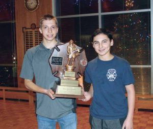 Former Captain Ryan Motchkavitz (left) was presented with an award by newly elected Captain David Oginski.