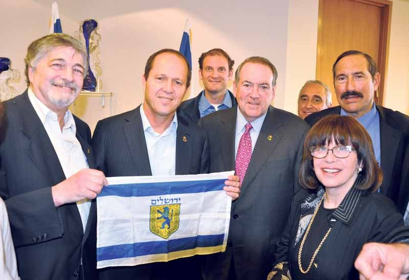 From left (front row): Brody holding the flag of Jerusalem with Barkat; Huckabee; Vice Presidents Public Policy OJC Odeleya Jacobs and Dr. Joe Frager; back row: activist Yisroel Stefansky; Israel Executive Director Ateret Cohanim and Daniel Luria (Photo by Itsik Nisim)