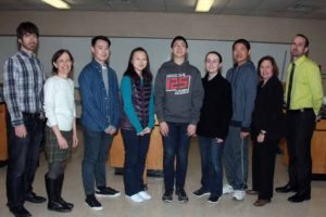 South High School's Regeneron Scholars (from third from left): Lynn Hlaing, Yujia Su, Matthew Ko, Olivia Lundelius and Jaysen Zhang are surrounded by science research teachers Drs. James Truglio and Carol Hersh, Principal Susan Elliott and Science Department Head Bradley Krauz. Scholar Rubin Smith is not pictured.