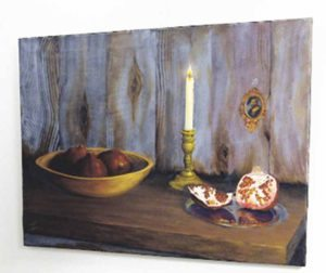 """Pomegranates"" by local artist Mario Tucci depicts a rather religious setting by using more contemporary styles of painting, thus uniting the various art genres represented within the gallery."