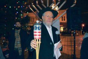 Chabad's Rabbi Yoseph Y. Geisinsky prepares for the menorah lighting.