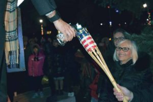 Town of North Hempstead Supervisor Judi Bosworth lit a candle.
