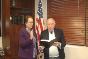 Great Neck Water Pollution Control District Commissioner Patty Katz takes the oath of office at the recent swearing-in ceremony.