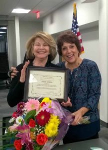 Great Neck Library Board of Trustees President Marietta DiCamillo (right) presented outgoing Treasurer Josie Pizer with a certificate of appreciation and flowers at the Jan. 17 Board of Trustees meeting.