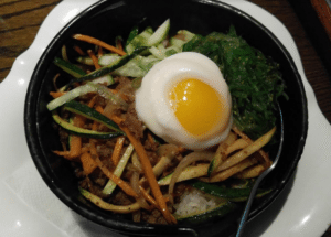 Mizu's Bibimbap, a Korean-style rice bowl with fresh vegetables and ground beef, adds variety to the primarily Japanese menu.
