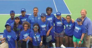 The contest winners, including Sophia Schutte (far right), at Arthur Ashe Kids Day with USTA Foundation Executive Director Dan Faber.