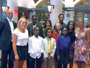 James Blake, retired pro and president of NYJTL, and Katrina Adams, USTA CEO, bookend the essay winners.