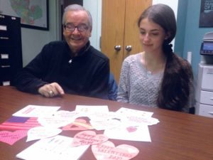 Assemblyman Anthony D'Urso and intern Emma Motelson are pictured with some of the handmade valentines delivered to the district office.