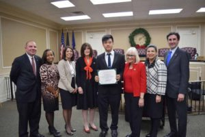 Shawn Kang from William A. Shine Great Neck South High School with town officials