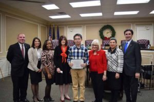 Hanxuan Kuang from William A. Shine Great Neck South High School with town officials