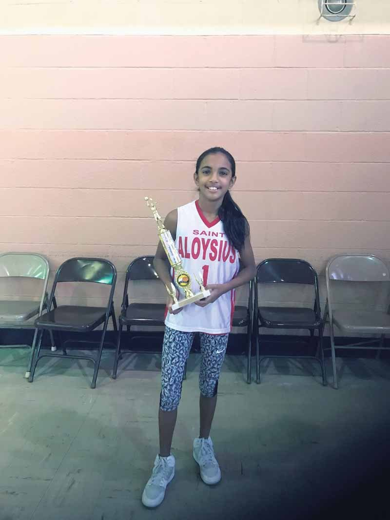 Shreya Deochard earned a first-place trophy for the free-throw competition at the Saint Vincent's Tournament.