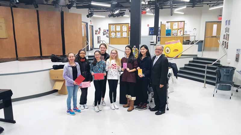 Levels teens make Valentines for Veterans (from left): Sabrina Niceforo, Abigail Garcia,  Gabriella Niceforo, Sara Fiala, Jamie Fleshel, Emily Hu, Cindy Hu and Assemblyman Anthony D'Urso.