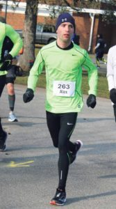 Alex Schneider strides through Eisenhower Park in the Presidential Inauguration Half Marathon.