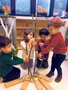 Morah Reena's Nursery Bet class explores trees and build their own as they learn about Tu B'Shevat.