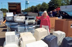 Supervisor Judi Bosworth with e-waste at a recent STOP event